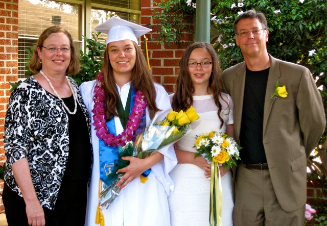 John and his family at his eldest daughter's high school graduation